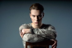 Young, fashion, handsome, caucasian, man sitting in the chair