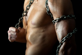 Handsome and muscular guy with chain