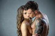 Charming model lovingly looks at tattooed man