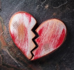Broken heart on slate background