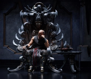 Vin Diesel in Riddick after he kills the Lord Marshall in Chronicles of Riddick. Yes, I know this is a direct rip off of a Conan scene, but.. I couldn't find a good screen cap of that, so sue me.