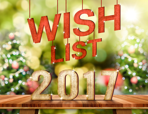 Wish list 2017 number on Brown Wood table top with abstract blur