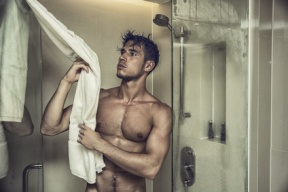 Attractive Young Bare Muscular Man after Taking Shower