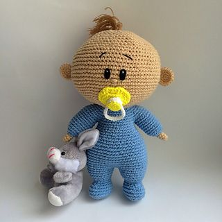 knitted baby and dummy
